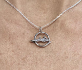 Coxswain with Rower in Open Circle Pendant by Rubini jewelers.