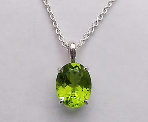 Oval Peridot in Basket Setting Pendant, by Rubini Jewelers
