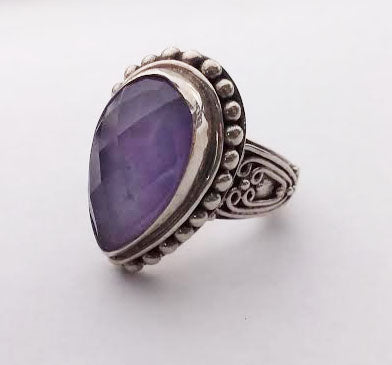 This ring features a beautiful faceted pear shaped lavender jade stone set in sterling silver with a beaded design.