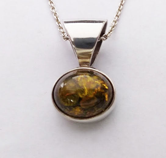 Simple and elegant, this pendant features a vibrant 10x13mm amber cabochon set in sterling silver with a very large bail, great for hefty chains.