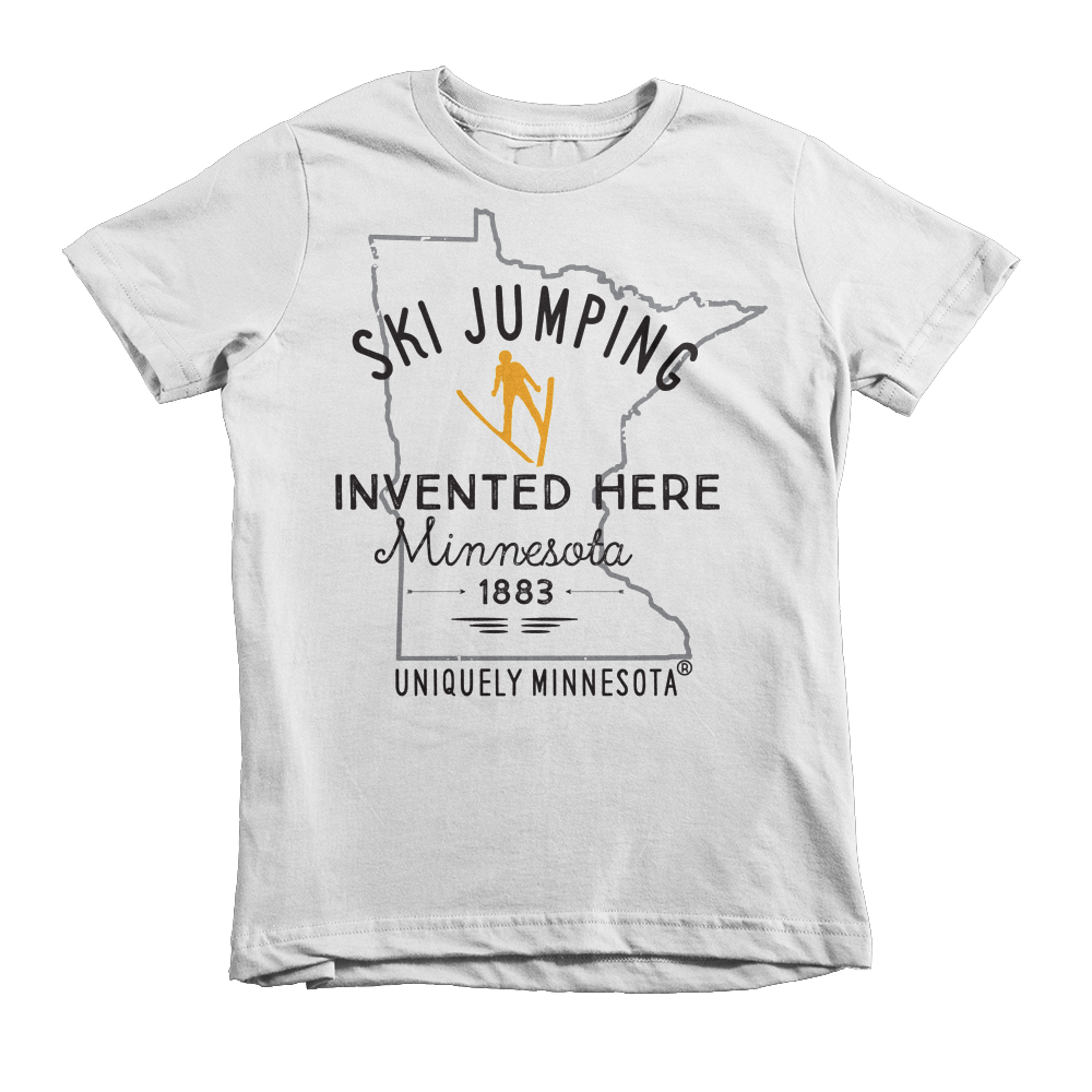 The Shop at Uniquely Minnesota white kids Ski Jumping Invented in Minnesota t-shirt on 100% cotton.