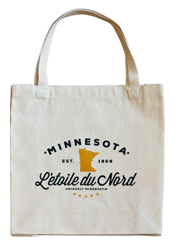 "The Shop at Uniquely Minnesota state motto L'etoile du Nord, ""Star of the North,"" logo on 100% cotton canvas tote."