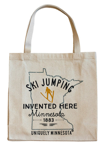 The Shop at Uniquely Minnesota 100% cotton canvas tote with MN ski jumping logo with golden skier icon.