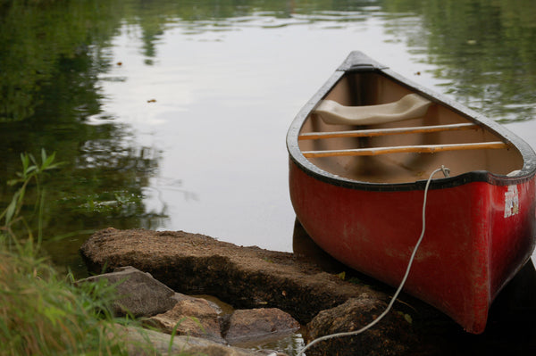 A canoe resting in the Boundary Waters in Minnesota, an international wilderness destination.