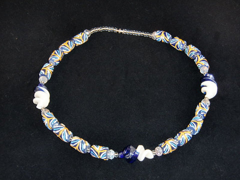 "Blue beads, w/orange & white painted designs and distinctive swirled accent beads; on nylon wire; approx. 18"" long; w/screw clasp."