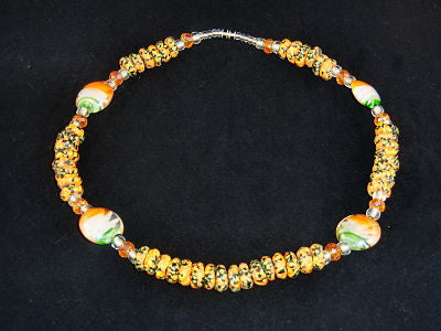 "Orange & green round stone w/matching glass accents; on nylon wire; approx. 18"" long; w/screw clasp."