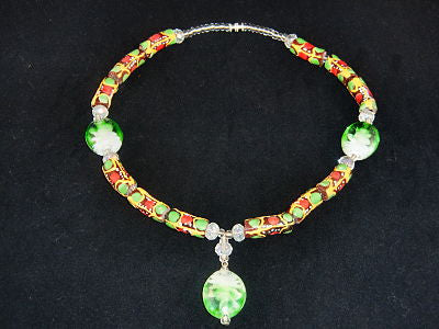 "Brown beads, w/orange, red & green painted designs with green accent stones; on nylon wire; approx. 18"" long; w/screw clasp."