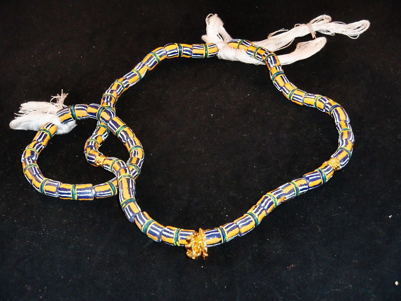 "Blue w/hand-painted orange, white lines & golden accents; on string / tie-on; neck beads approx. 25"" long; wrist beads approx. 10 1/2"" long."