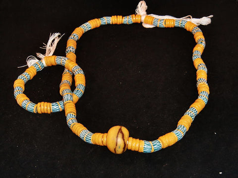 "Sky blue w/beige spacer beads, hand-painted beige designs & accent stone; on string / tie-on; neck beads approx. 36"" long; wrist beads approx. 11"" long."