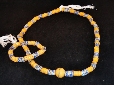 "Blue w/beige spacer beads, hand-painted beige designs & accent stone; on string / tie-on; neck beads approx. 36"" long; wrist beads approx. 11"" long."