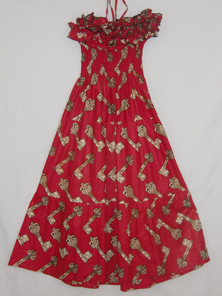 "Hi-Target wax print cloth of white keys on a red background; hand-tailored, 'topless' w/neck strap; ruffled front; floor length A-line dress; w/elastic gathered bodice &; back; approx. 48""; long from shoulder to hem. STRETCHES TO FIT S-M-L."