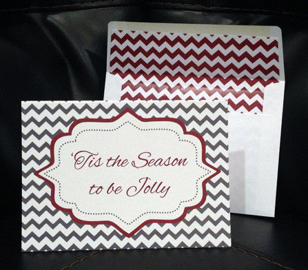 grey chevron stripe background with red bracket design that includes holiday greeting