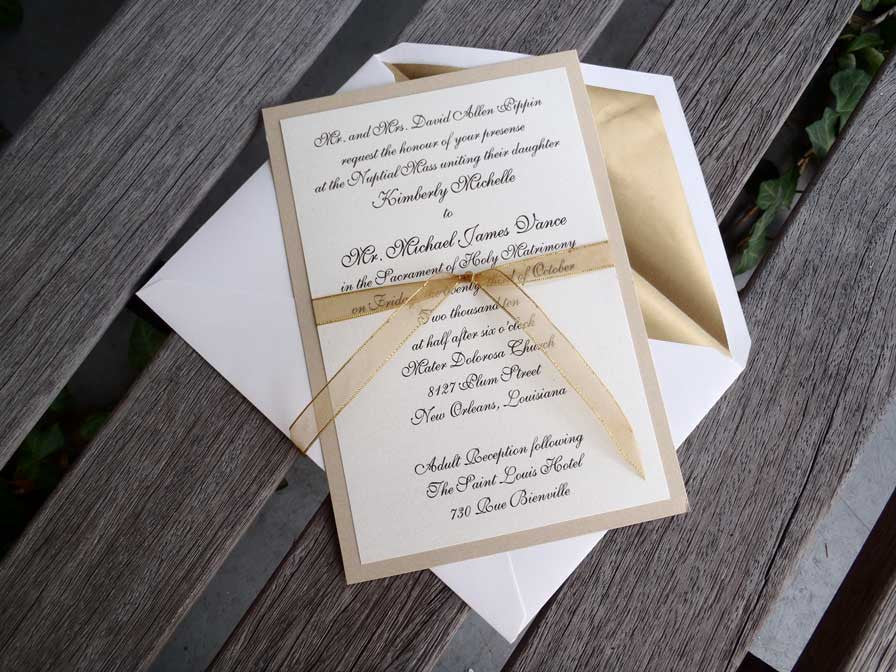 ivory and gold layered wedding invitation with ribbon