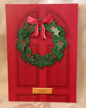 red door card with die cut green Christmas wreath