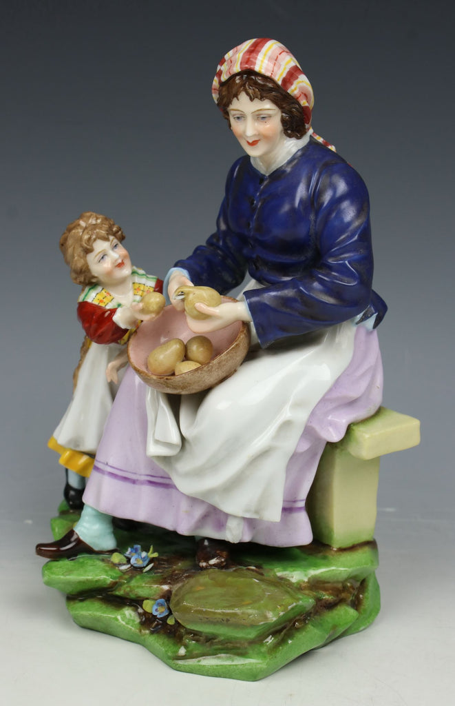 "Antique E&A Muller figurine ""Woman and Child Peeling Potatoes"""