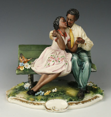 "Capodimonte Luciano Cazzola Figurine ""Courting Couple on Bench"""