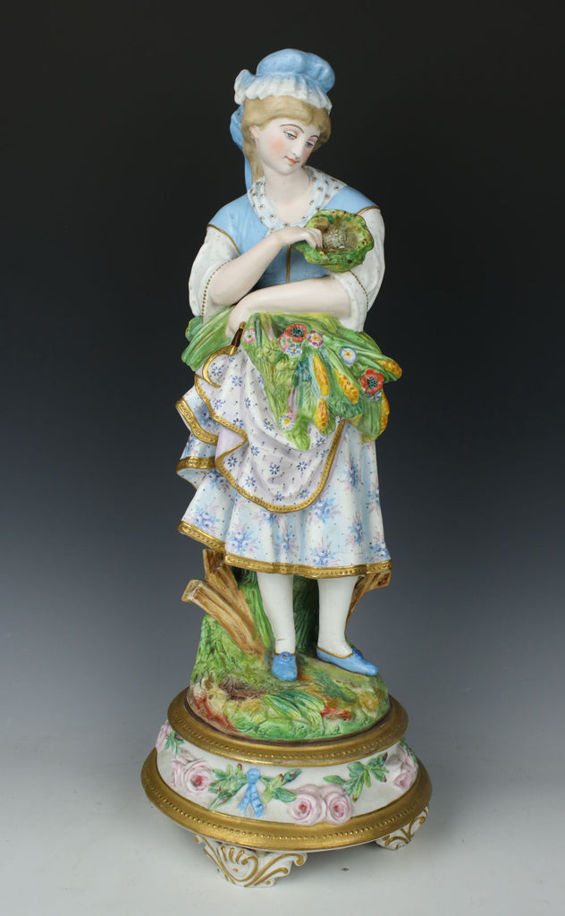 "Antique 19C French porcelain figurine ""Girl with Flowers and Eggs"""