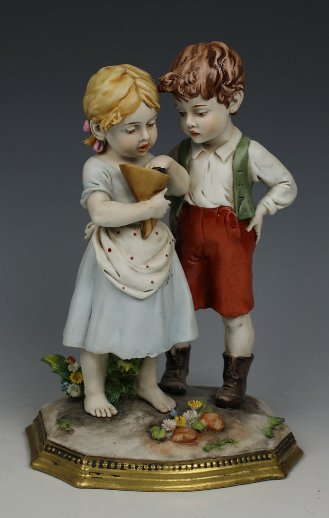 "Capodimonte Benacchio Figurine ""Boy and Girl Eating Candies"""