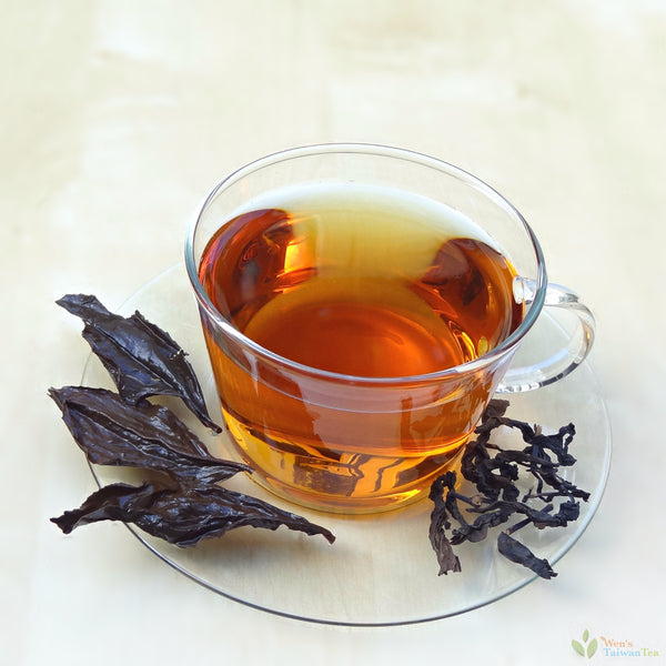 Honey black tea - dark amber tea liquid - full leaves