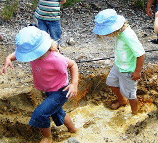 Kids playing on the mud