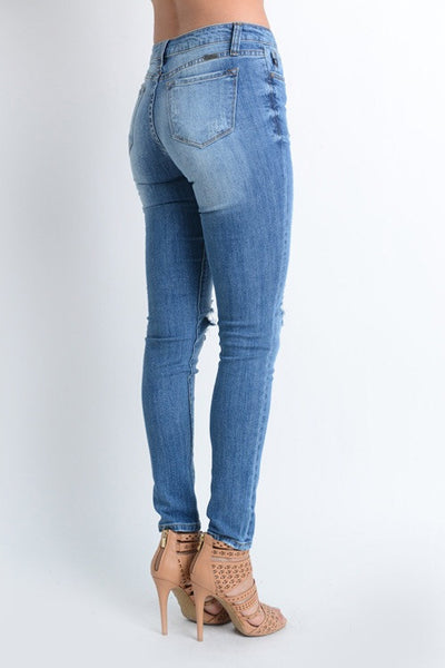 LIGHT/MEDIUM WASH DISTRESSED SKINNY JEAN