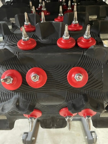 Snowmobile studs installed using TracSpec™ Template