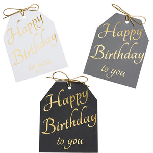 Gold foil Happy Birthday to you gift tags. White, gray, and black linen paper with metallic gold ties. 4x5.5
