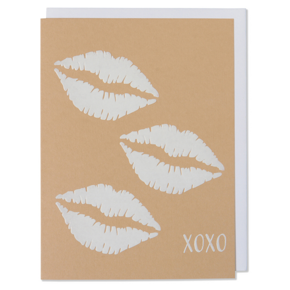 Lips XOXO White Foil Embossed Card on Tan Paper with a bright white envelope