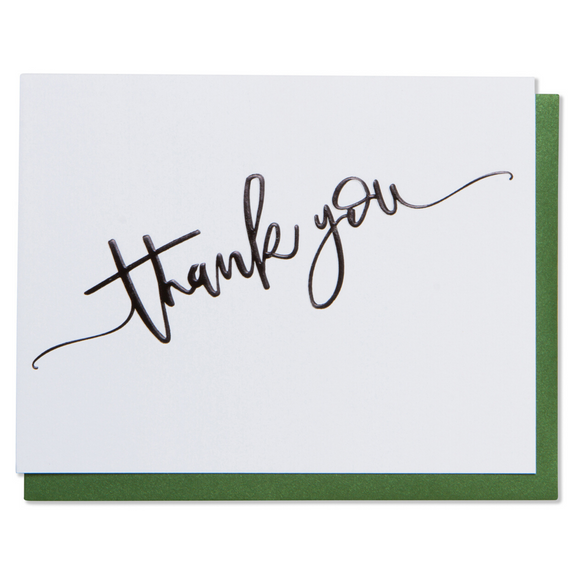 Thank you card. Black foil embossed on bright white paper with a metallic green or metallic red envelope.