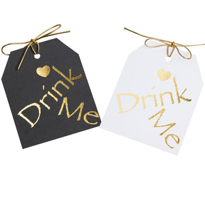 "Gold foil on black or white paper.Drimk Me gift tags with a gold heart above the word Drimk Me. 3.5x4"" wirh  gold metallic tie"