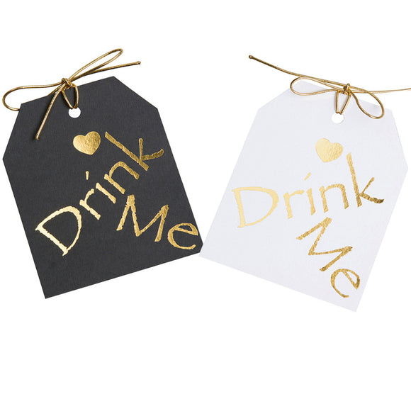 Gold foil on black or white paper.Drimk Me gift tags with a gold heart above the word Drimk Me. 3.5x4