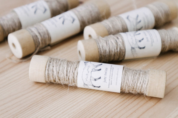 Handspun natural jute twine on wooden spool