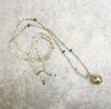 The silver and gold bola necklace
