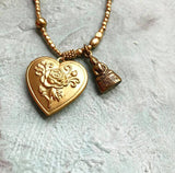 Buddha heart locket necklace