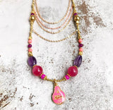 Pink Buddha amulet necklace