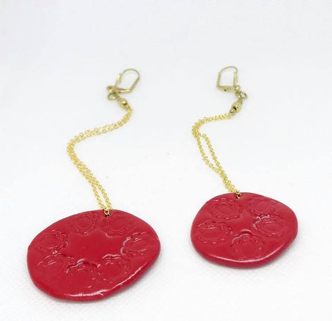 Asymmetric red circle earrings