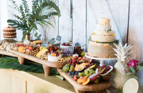 a traditional rustic wedding grazing table by tasty table catering