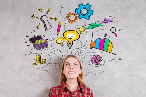 woman imagining creative ideas for success
