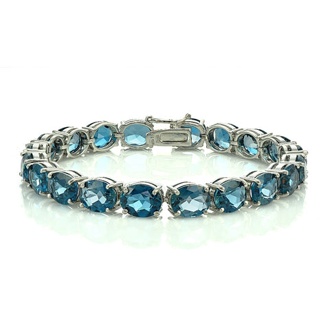 Sterling Silver 42ct London Blue Topaz 9x7mm Oval Tennis Bracelet