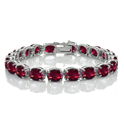 Sterling Silver 40ct Created Ruby 9x7mm Oval Tennis Bracelet