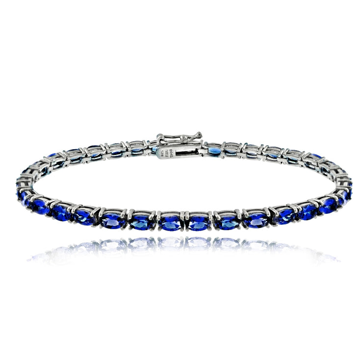 Sterling Silver 6.2ct Created Blue Sapphire 5x3mm Oval Tennis Bracelet