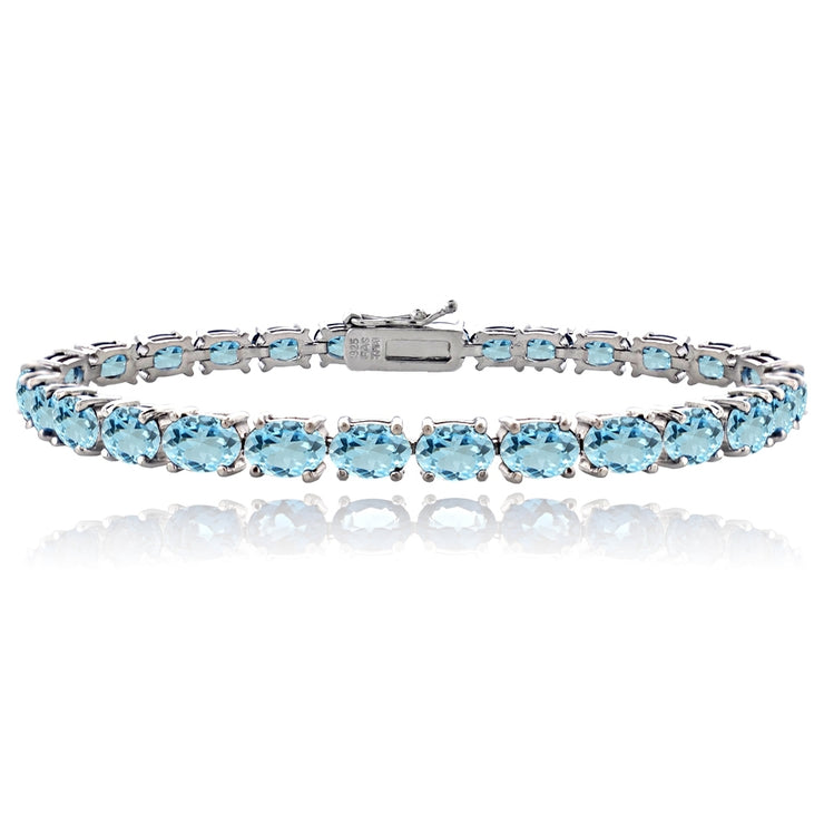 Sterling Silver 14.4ct Blue Topaz 6x4mm Oval Tennis Bracelet