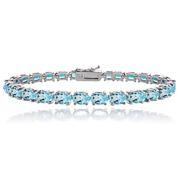 Sterling Silver 14.4ct Swiss Blue Topaz 6x4mm Oval Tennis Bracelet