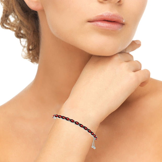 Sterling Silver 5x3mm Created Ruby Oval-Cut Adjustable Bracelet