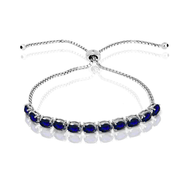 Sterling Silver Created Blue Sapphire 6x4mm Oval-cut Adjustable Tennis Bracelet