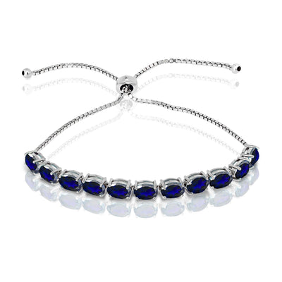Sterling Silver Created Blue Sapphire 7x5mm Oval-cut Adjustable Tennis Bracelet