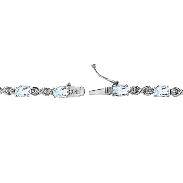 Sterling Silver Blue Topaz 6x4mm Oval Infinity Bracelet with White Topaz Accents