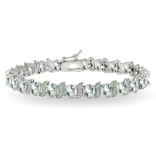 Sterling Silver Aquamarine 6x4mm Oval and S Tennis Bracelet with White Topaz Accents