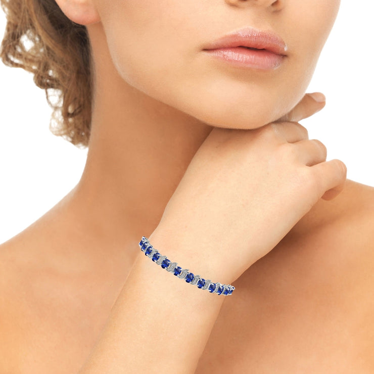 Sterling Silver Created Blue Sapphire 6x4mm Oval and S Tennis Bracelet with White Topaz Accents