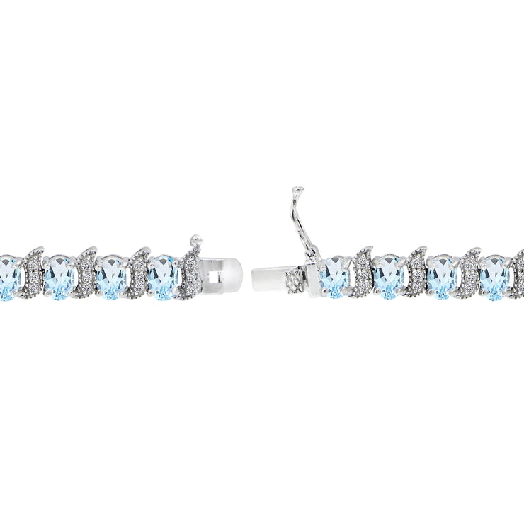 Sterling Silver Blue Topaz 6x4mm Oval and S Tennis Bracelet with White Topaz Accents